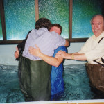Mac and Mary's father baptizing